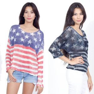 Made in the USA, this fashionable True Hitt sweater is available in soft red, white and blue or trendy black and white