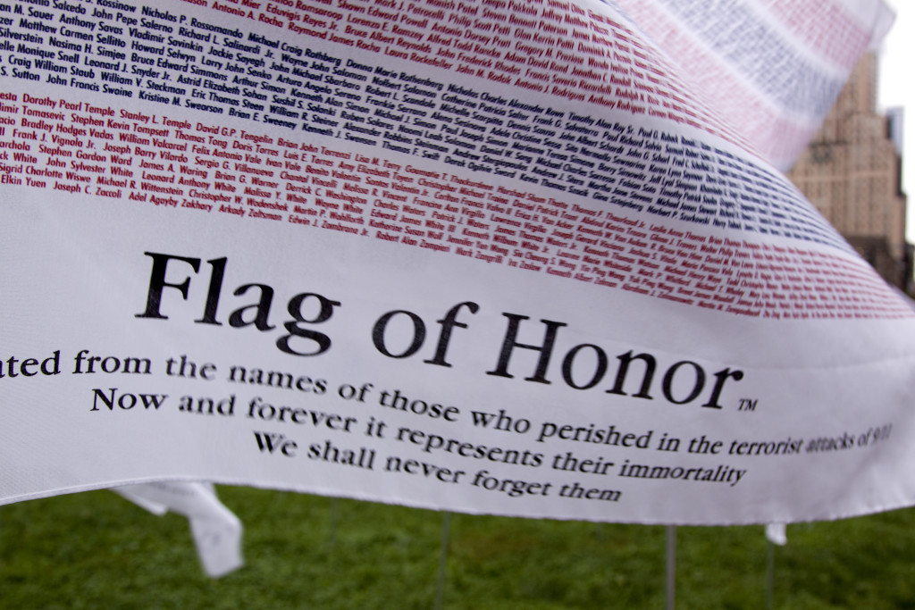 NEW YORK - SEPT 11: One of the 3,000 Flags of Honor displayed in Battery Park with names of all victims of the terror attacks on the 10th anniversary of 9/11 on September 11, 2011 in New York.